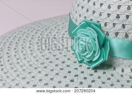 A Broad-brimmed Female Hat Is Light Green, Decorated With Ribbon And Homemade Flower. Artificial Flo