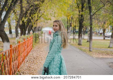 The Girl Walks In The Park In The Fall. Autumn Wood. Walk In The Fall On The Wood.