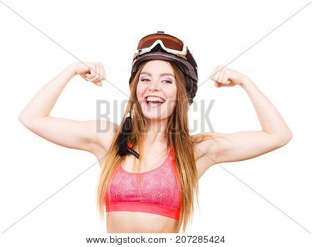 Woman Wearing Ski Suit, Helmet With Goggles Showing Muscles
