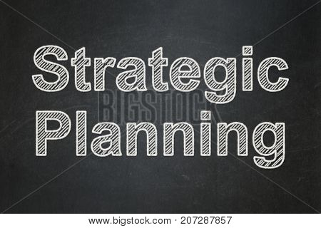 Business concept: text Strategic Planning on Black chalkboard background