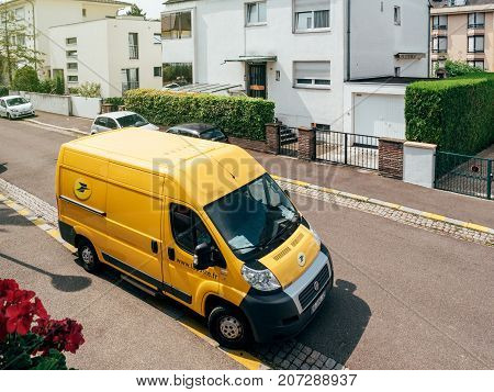 PARIS FRANCE - JUN 23 2017: La Poste yellow delivery van for the delivery on time package parcel - aerial view