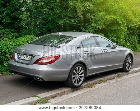STUTTGART GERMANY - SEP 7 2017: Rear view of luxury Mercedes-Benz CLS 350d Klass detail on parked on a European city street at sunset