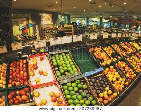 FRANKFURT GERMANY - MAY 3 2017: large selection of apples in German Edeka supermarket - shopping for the best fruits and vegetables in the fresh Organic bio store