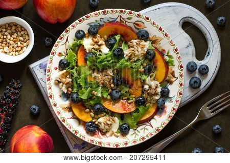 Salad With Nectarine Blueberry Mozzarella And Nuts