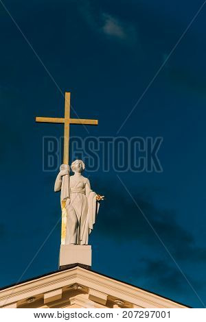 Vilnius, Lithuania. Close View Of Statue Of St. Helena With Cross On Roof Of Cathedral Basilica Of St Stanislaus And St Ladislaus.