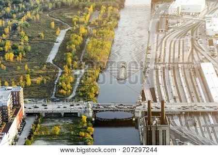 canal with boat and trafficated bridge in Chicago