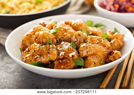 Spicy sweet and sour general tso chicken with fried rice and purple cabbage