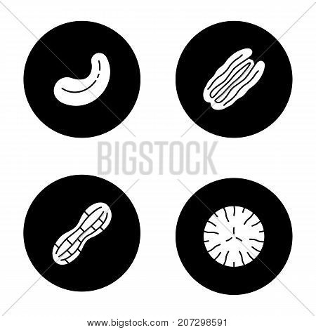 Nuts types glyph icons set. Cashew and pecan nuts, peanut, nutmeg. Vector white silhouettes illustrations in black circles