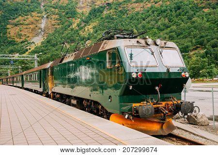 Flam, Norway. Famous Railroad Flamsbahn. Green Norwegian Train Near Railway Station. Electric train