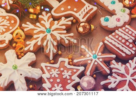 christmas gingerbread frosted cookies with christmas decorations - christmas food background, retro toned