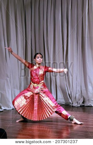 AUSTIN, TEXAS - SEPTEMBER 30, 2017: Aruna Kharod performing bharatanatyam classical dance in Blanton Museum of Art. Performance is related to paintings in the Epic Tales from Ancient India exhibition