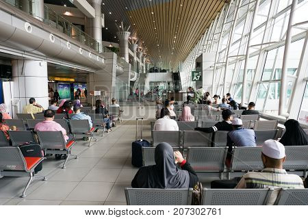Kota Kinabalu, Malaysia - September 06, 2017: Traveler Waiting To Board At The Departure Lounge In K