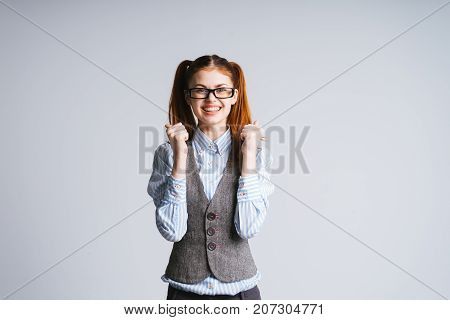 smiling student female enthusiastically holding hands on a white background