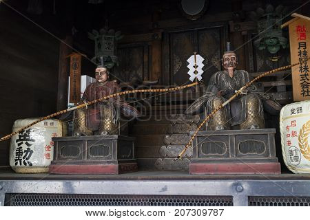 Kyoto, Japan -  May 18, 2017:  Traditional wooden sculptured Gate-keepers at a shrine in the Shijo-dori