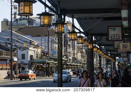 Kyoto, Japan - May 18, 2017: Pedestrians and traffic on the Shijio-Dori, major and busy shoppingstreet