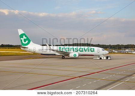 EINDHOVEN, THE NETHERLANDS - SEPTEMBER 20, 2017: Transavia Boeing 737-800 airliner pushed back for departure. Transavia is a Dutch low-cost airline, a subsidiary of KLM