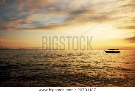 Lonely boat upon golden twilight