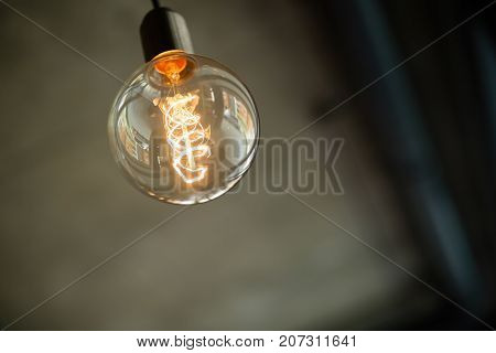 Glowing retro vintage light bulb used for decoration