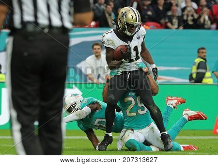 LONDON, ENGLAND - OCTOBER 01 2017: New Orleans Saints running back Alvin Kamara (41) scores a touchdown during the NFL match between the Miami Dolphins and the New Orleans Saints at Wembley Stadium