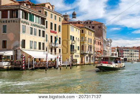 VENICE,ITALY - JULY 26,2017 : Vaporetto or water bus at the Grand Canal in Venice on a sunny summer day