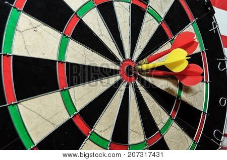 Three darts arrows in the target center in bull's eye. Business goal concept