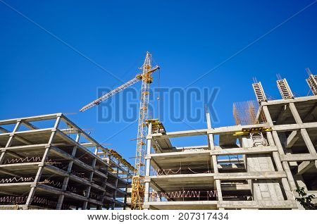 Construction site with cranes with copy space for your text