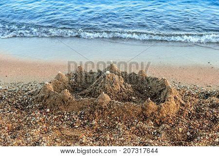 Simple sand castle on the beach