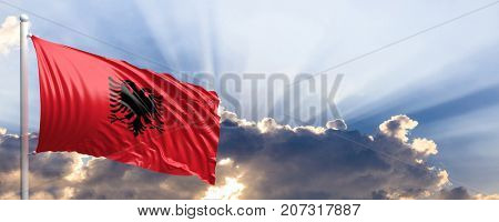 Albania waving flag on blue sky. 3d illustration