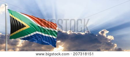 South Africa waving flag on blue sky. 3d illustration