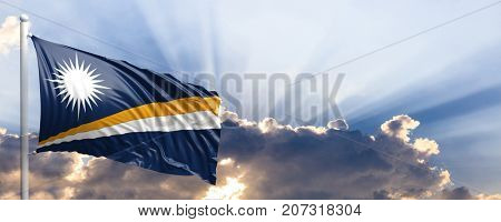Marshall Islands waving flag on blue sky. 3d illustration