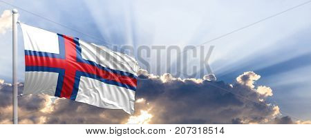 Faroe Islands waving flag on blue sky. 3d illustration