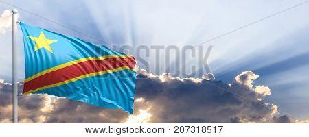 Congo waving flag on blue sky. 3d illustration