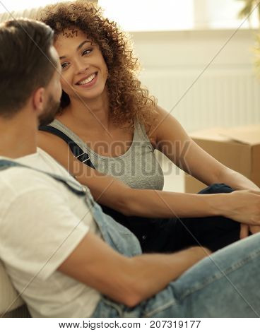 Close-up of newlyweds sitting on the couch in a new apartment