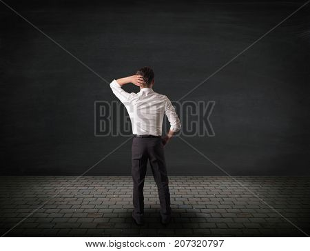 Business man with different choices concept image with blank chalkboard