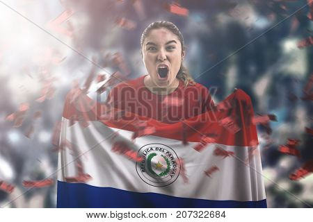 Paraguayan female fan holding the national flag
