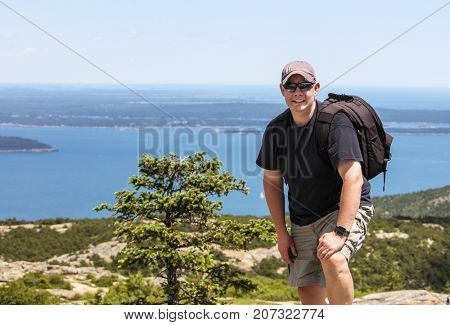 Man with backpack hiking in Maine