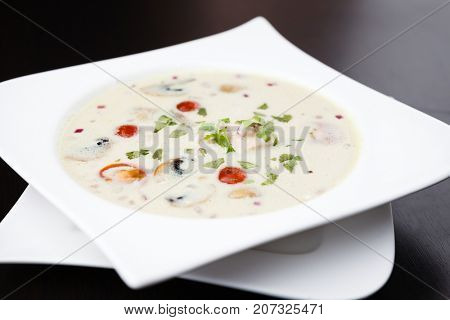 Coconut milk with chicken. Traditional thai soup Tom Kha