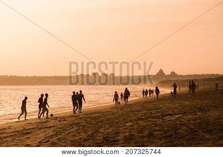 Sun is setting in a beach on Algarve- Portugal