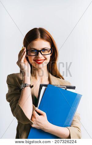 girl secretary in glasses holds a folder in her hand