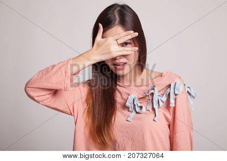 Beautiful Young Asian Woman Peeking Through Fingers.
