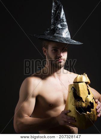 Halloween Man In Witch Hat On Black Background