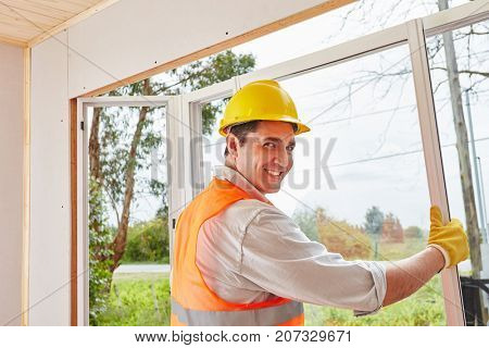 Man as skilled window fitter assembles new window