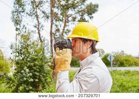 Construction worker drinking coffee at construction site
