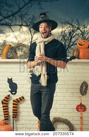 Halloween Macho With Open Mouth Wearing Witch Hat And Scarf