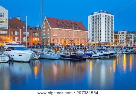 GDANSK, POLAND - AUGUST 14, 2017: Summer scenery of Motlawa river and marina in Gdansk at night, Poland. Gdansk is the historical capital of Polish Pomerania.