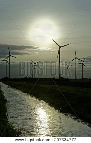 Wind turbines and drainage dyke in Lincolnshire UK