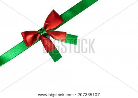 Red and green christmas ribbon bow isolated on white background