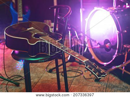 Guitar at concert on the stage with colorful light