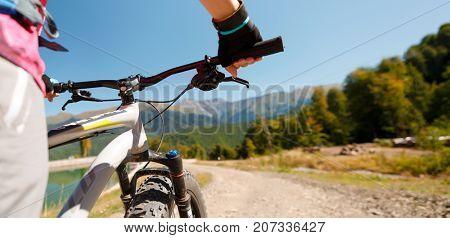 Photo of girl wearing gloves on mountain bike