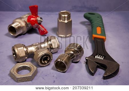 adjust wrench power grip and elements of water and gas shutoff valvessmall depth of sharpness